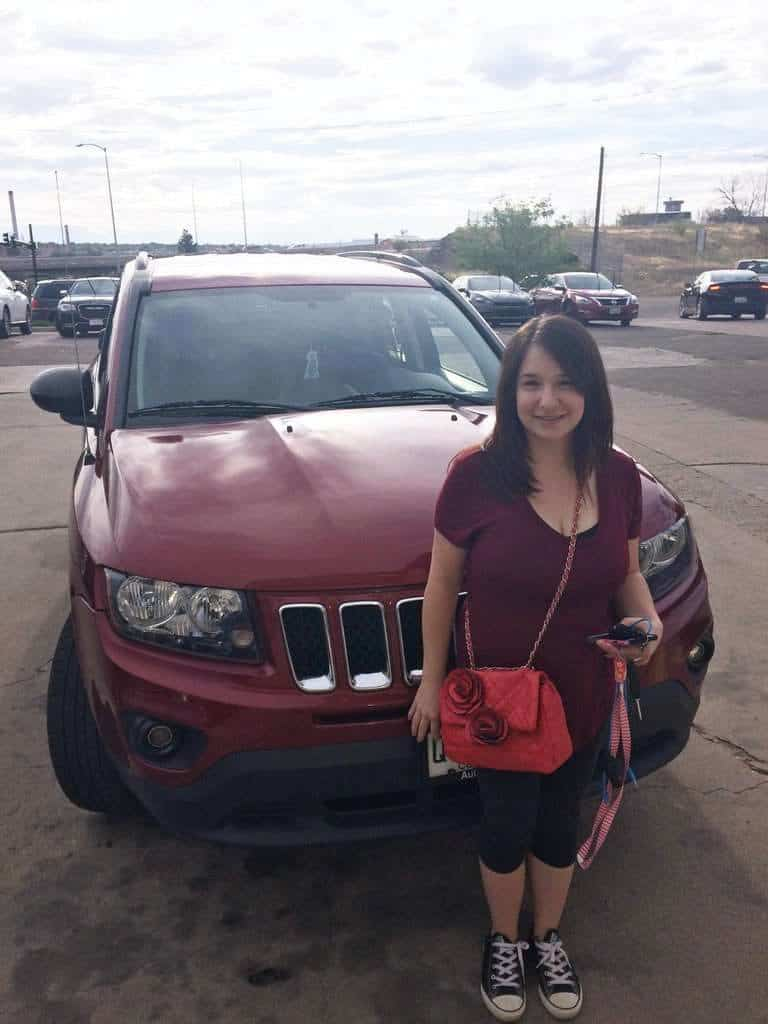 "Mrs. Brandy Medina picking up her 2014 Jeep Compass says, ""I am very happy with the work I received from PH&DCO, It took 1 day total to fix and that was REALLY awesome. I am very, very satisfied with the customer service I received with Platinum....so, thank you very much Platinum"""