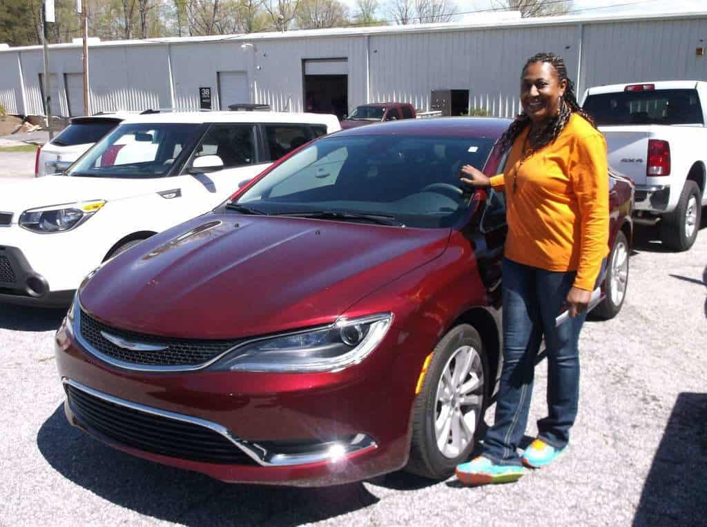 "Frankie Anderson picking up her 2015 Chrysler 300 says, ""Platinum Hail & Dent Co. REALLY took care of me. It was a quick and easy process. I did not have to wait on a FREE rental car either, they had everything ready to go. I would recommend PH&D Co to everyone!"""
