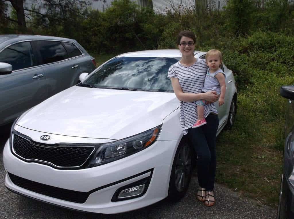 "Kristyn Gizzy from Taylors, SC picking up her repaired 2015 Kia Optima that was 2 weeks old when the hail storm hit. Kristyn states, ""I am very satisfied with Platinum Hail & Dent Co's service! My vehicle looks brand new again!"""